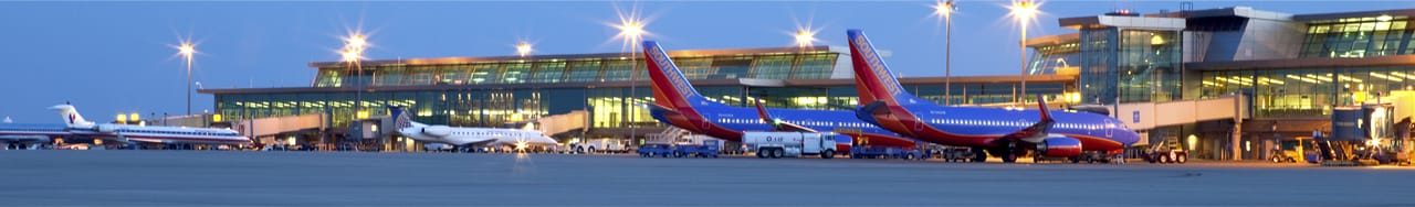 Commercial jets sitting at airport gates, Will Rogers World Airport, Southwest, United, American