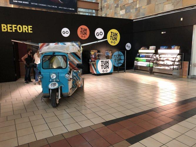 blue food cart setup with beverage, sandwich and salad options for sale