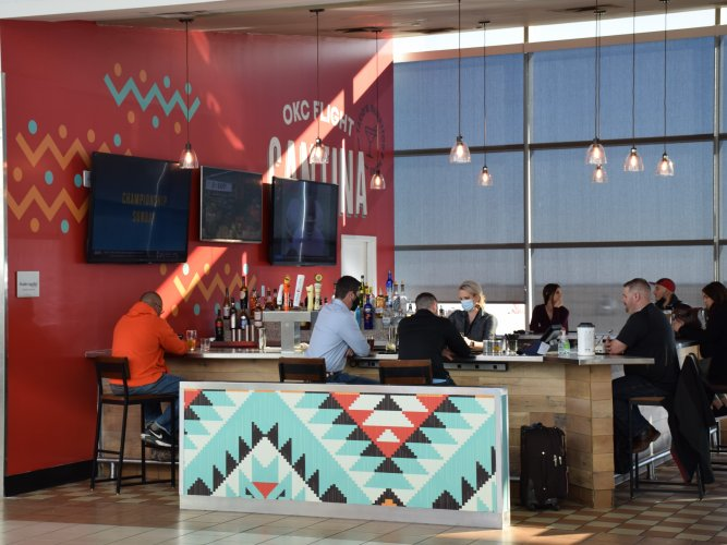 View of OKC Flight Cantina Bar, looking in from west concourse between gates 8 and 10