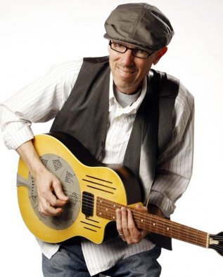 Mark Bruner playing guitar, white background